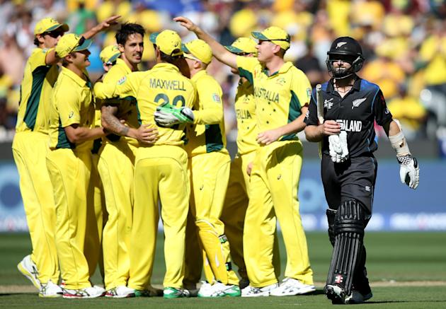 New Zealand's Kane Williamson walks from the field after he was dismissed by Australia's Mitchell Johnson during the Cricket World Cup final in Melbourne, Australia, Sunday, March 29, 2015. (AP Ph