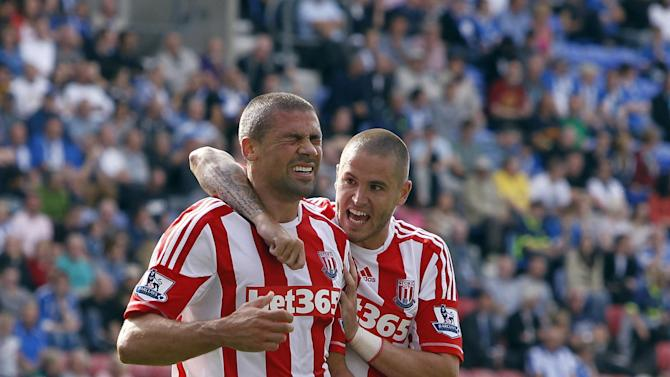 Jonathan Walters, left, equalised for Stoke on a hectic afternoon