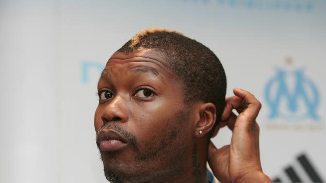 File photo of French striker Djibril Cisse during a news conference in Marseille