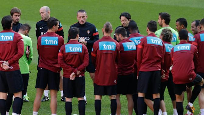 Portugal's coach Paulo Bento, background center, talks to the players during a training session Sunday, Nov. 17 2013, at the Luz stadium in Lisbon. Portugal will play Sweden Tuesday in a World Cup qualifying playoff second-leg soccer match