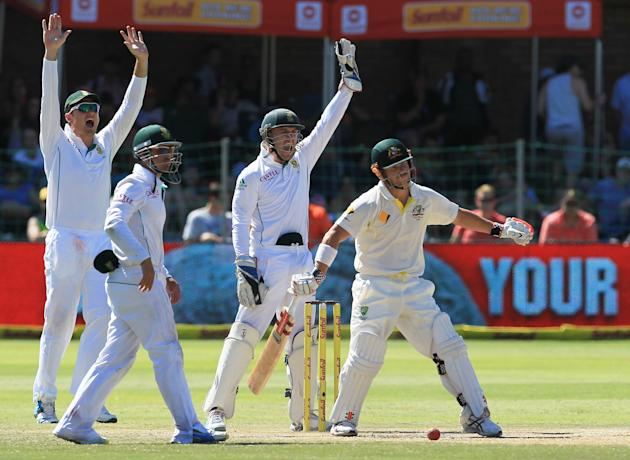 South Africa's players appeal successfully for LBW against Australia's batsman David Warner, right, on the fourth day of their 2nd cricket test match at St George's Park in Port Elizabeth,