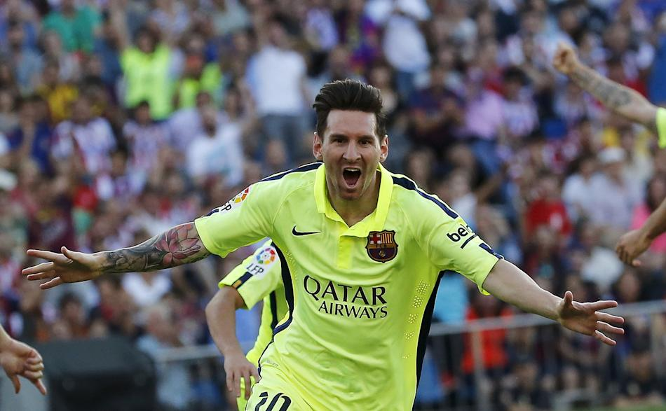 Barcelona's Messi celebrates his goal against Atletico Madrid during their Spanish first division soccer match at Vicente Calderon stadium in Madrid