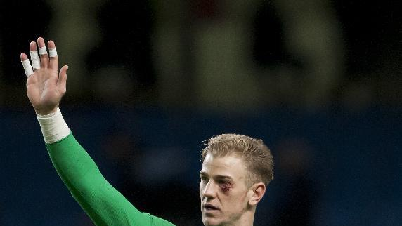 Sporting a cut below his left eye Manchester City's goalkeeper Joe Hart waves to the crowd after his team's 1-0 win against Crystal Palace in their English Premier League soccer match at the Etihad Stadium, Manchester, England, Saturday Dec. 28, 2013