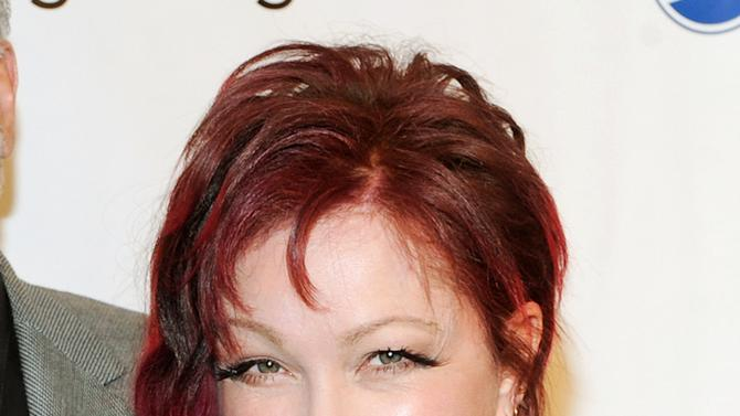 "FILE - This May 17, 2013 file photo shows Cyndi Lauper at the 79th Annual Drama League awards at the Marriott Marquis Times Square  in New York. More singer-songwriters from the rock and pop world are turning to the stage. Lauper, along with John Mellencamp, Sarah McLachlan, Tori Amos, Edie Brickell, David Byrne, Fatboy Slim, Burt Bacharach, Elvis Costello and The Flaming Lips are making musicals. Lauper's ""Kinky Boots,"" was nominated for a Tony for best musical. (Photo by Evan Agostini/Invision/AP, file)"