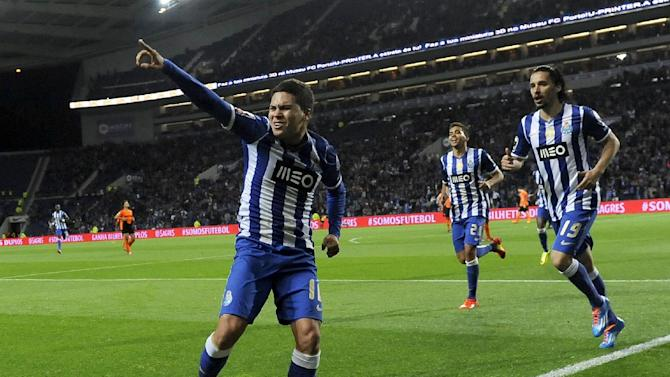 FC Porto's Juan Quintero, left, from Colombia celebrates after scoring against Belenenses in a Portuguese League soccer match at the Dragao stadium in Porto, Portugal, Sunday, March 23, 2014. Quintero scored the only goal in Porto's 1-0 victory