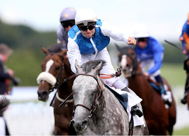 Maxime Guyon on Solow celebrates winning the 3:10 Qatar Sussex Stakes (British Champions Series)