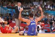 "American Coleman Scott (R) celebrates winning the Men's 60kg Freestyle bronze medal match on August 11, 2012 during the wrestling event of the London 2012 Olympic Games. ""We have to bond as a worldwide community to keep wrestling in the Games,"" said Scott"