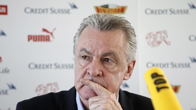 Switzerland's head coach Ottmar Hitzfeld attends a news conference in Bern, Switzerland, Thursday, Oct. 17, 2013, where he announced that he will leave his job after the soccer World Cup in Brazil. Hitzfeld, who will be 65 after the tournament in Brazil, made his announcement barely an hour after Switzerland rose to No. 7 in the FIFA world rankings, making it one of the eight seeded teams