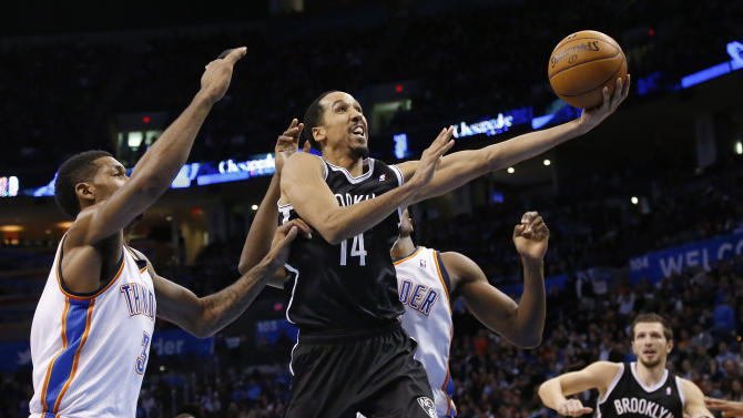 Brooklyn Nets guard Shaun Livingston (14) shoots in front of Oklahoma City Thunder forward Perry Jones (3) and forward Serge Ibaka in the second quarter of an NBA basketball game in Oklahoma City, Thursday, Jan. 2, 2014. (AP Photo/Sue Ogrocki)