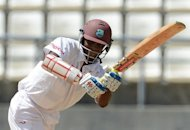 West Indies batsman Shivnarine Chanderpaul plays a shot during the third day of the third Test match against Australia in Roseau, Dominica, on April 25