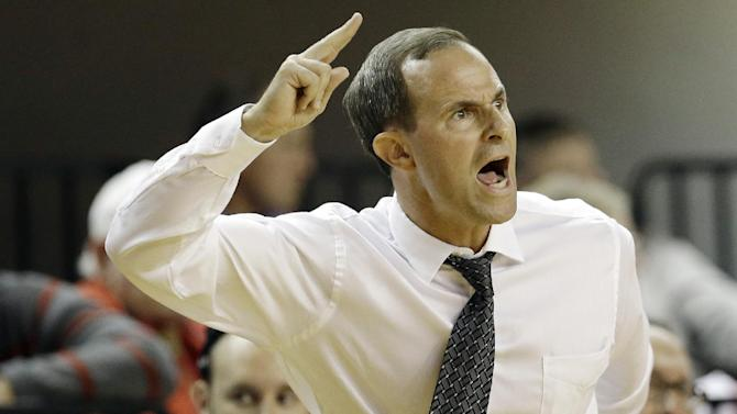 UNC Pembroke coach Ben Miller yells during the second half of an exhibition NCAA college basketball game against North Carolina State in Raleigh, N.C., Wednesday, Oct. 30, 2013. North Carolina State won 96-85