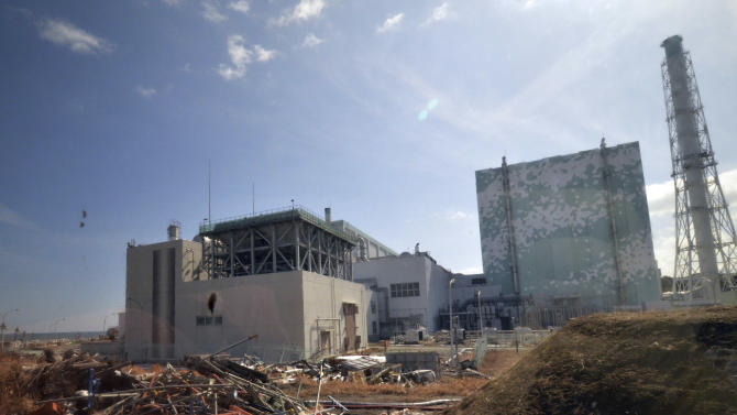 Debris is seen scattered near the Unit 6 reactor building of stricken Fukushima Dai-ichi nuclear power plant of Tokyo Electric Power Co., in Okuma town, Fukushima prefecture, northeastern Japan Tuesday, Feb. 28, 2012. Japan next month marks one year since the March 11 tsunami and earthquake, which triggered the worst nuclear accident since Chernobyl in 1986.  (AP Photo/Yoshikazu Tsuno, Pool)