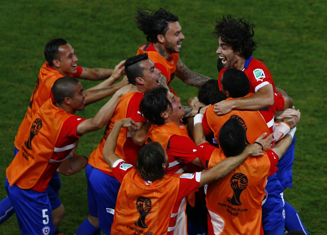 Chile's Jorge Valdivia celebrates his goal against Australia with his teammates during their 2014 World Cup Group B soccer match at the Pantanal...