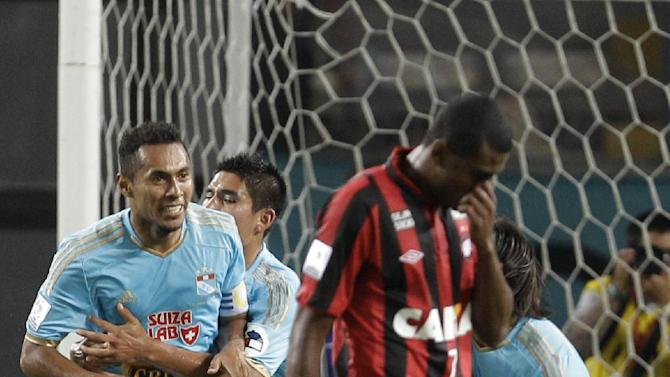 Carlos Lobaton of Peru's Sporting Cristal, left, celebrates with teammates after he scored against Brazil's Atletico Paranaense during a Copa Libertadores soccer match in Lima, Peru, Wednesday, Jan. 29, 2014