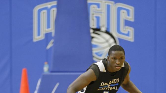 Orlando Magic's Victor Oladipo works on ball handling skills during NBA basketball training camp, Tuesday, Oct. 1, 2013, in Orlando, Fla
