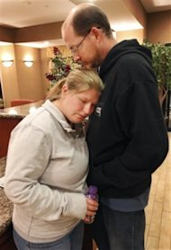 Deborah Bradley, left, and Jeremy Irwin in the lobby of a Kansas City hotel on October 7, 2011, three days after their 10-month-old daughter, Lisa, disappeared from their home. (Photo: Orlin Wagner/AP)