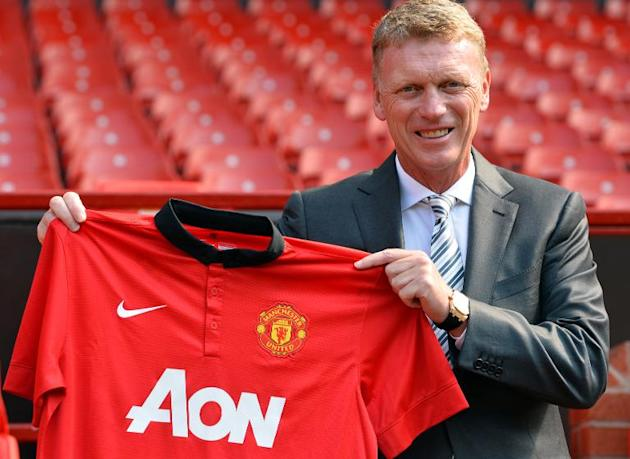 File picture taken on July 5, 2013 shows Manchester United's new Scottish manager David Moyes holding up a club shirt during a photocall at Old Trafford in Manchester, north-west England