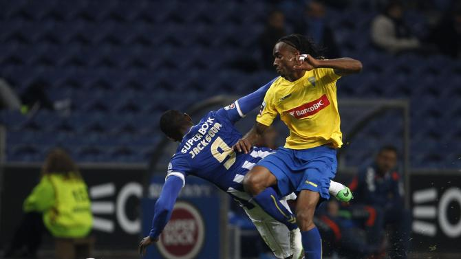 Porto's Martinez fights for the ball with Estoril's Balboa during their Portuguese premier league soccer match in Porto