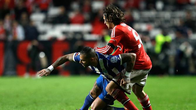 Porto's Ricardo Quaresma, left, fights for the ball with Benfica's Lazar Markovic during their Portuguese league soccer match Sunday, Jan. 12 2014, at Benfica's Luz stadium in Lisbon