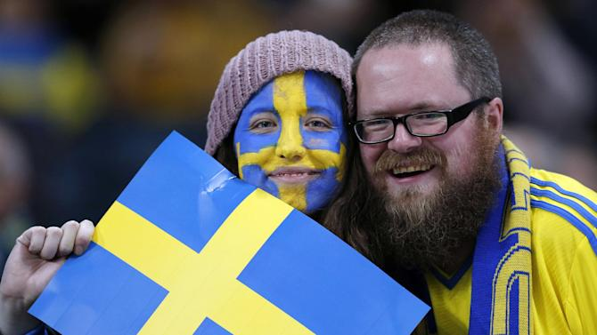 FILE - In this Tuesday, Nov. 19, 2013 file photo, Sweden fans pose with a Swedish flag before the World Cup qualifying soccer match between Sweden and Portugal in Stockholm, Sweden. For the first time since record-keeping began in 1749, Sweden now has more men than women. Swedes don't quite know what to make of this sudden male surplus, which is highly unusual in the West, where women historically have been in the majority in almost every country. But it may be a sign of things to come in Europe as changes in life expectancy and migration transform demographics. The tipping point in Sweden happened in March 2015, when population statistics showed 277 more men than women.  (AP Photo/Frank Augstein, file)