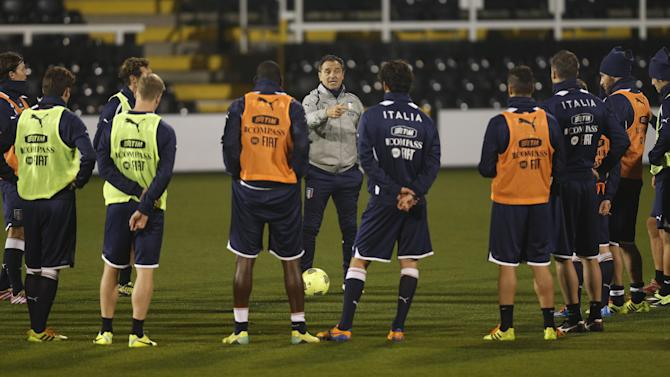 Italy's coach Cesare Prandelli, center, instructs his players during a training session at Craven Cottage in London, Sunday, Nov. 17, 2013. Italy is to play a friendly soccer match against Nigeria on Monday Nov. 18 at Craven Cottage in London