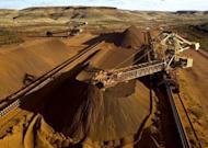 File photo of a reclaimer loading iron ore in Australia. Australia's mining industry on Tuesday warned of job losses, mine closures and projects put on hold after the Queensland state government announced a hike in the royalty rates paid on coal