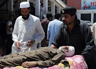 Pakistani relatives push a stretcher carrying an injured victim at a hospital in Peshawar, following a suicide bombing in Khar. Bajaur has been one of the toughest battlegrounds in Pakistan's fight against a northwestern Taliban insurgency