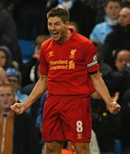 Steven Gerrard celebrates after putting Liverpool 2-1 ahead against Manchester City at the Etihad today