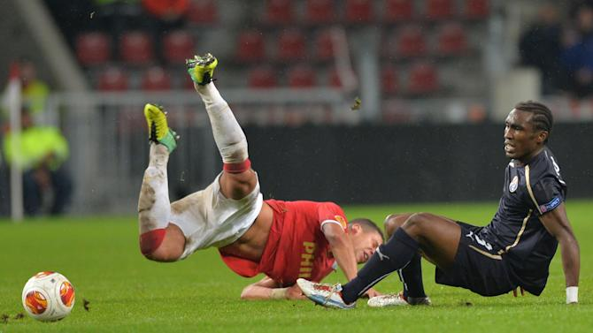 Dinamo's Lee Addy fights for the ball with Jeffrey Brumafrom PSV Eindhoven , right, during a Europa League group B  soccer match between PSV and Dinamo Zagreb at the Philips stadium in Eindhoven, southern Netherlands, Thursday, Nov.7, 2013