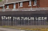 Anti-monarchy graffiti pictured on a wall in west Belfast, Northern Ireland. Queen Elizabeth II made a historic gesture in Northern Ireland's peace process when she shook the hand of former IRA commander Martin McGuinness