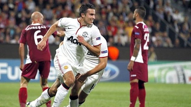 Manchester United's Robin van Persie (C) celebrates his goal against CFR Cluj during their Champions League Group H soccer match in Cluj-Napoca, 426 km (265 miles) northwest of Bucharest, October 2, 2012