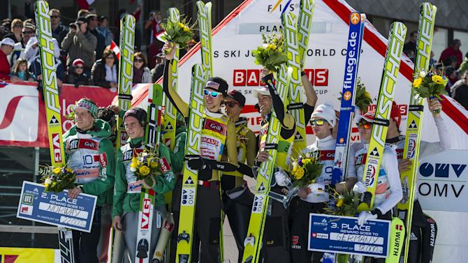 Winners Austrian team's Thomas Morgenstern, Andreas Kofler, Gregor Schlierenzauer, Martin Koch, (C), second-placed Norwegian Team (L), and third-placed German Team pose on the podium of the FIS Ski Flying World Cup Team event in Planica on March 17, 2012.   AFP PHOTO / Jure Makovec (Photo credit should read Jure Makovec/AFP/Getty Images)