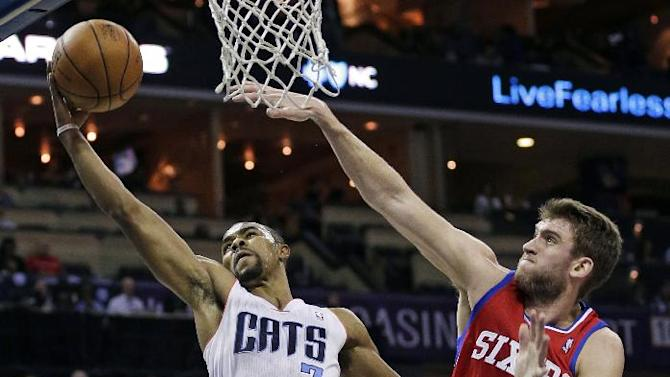 Charlotte Bobcats' Ramon Sessions (7) drives past Philadelphia 76ers' Spencer Hawes during the first half of an NBA basketball game in Charlotte, N.C., Friday, Dec. 6, 2013