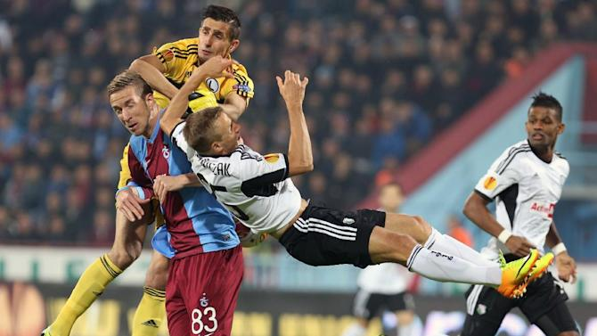 Trabzonspor's Janko, left, and Rzezniczak of Legia, front, fight for the ball during their Europa League Group J soccer match in Trabzon, Turkey, Thursday, Oct. 24, 2013. Legia's goalkeeper Skaba is at top left.  (AP Photo)