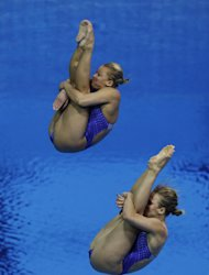 US Silver medalists Abigail Johnston, front, and Kelci Bryant, rear, compete during the 3 Meter Synchronized Springboard final at the Aquatics Centre in the Olympic Park during the 2012 Summer Olympics in London, Sunday, July 29, 2012. (AP Photo/Lefteris Pitarakis)