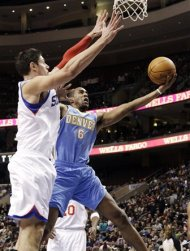 Denver Nuggets' Arron Afflalo (6) goes up for a shot as Philadelphia 76ers' Nikola Vucevic, of Switzerland, defends in the first half of an NBA basketball game, Wednesday, Jan. 18, 2012, in Philadelphia. (AP Photo/Matt Slocum)