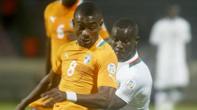 Ivory Coast's Kalou Salomon, left, is challenged by Senegal's Souare Pape Ndiaye, right, during their World Cup Group H qualifying soccer match at Mohammed V stadium in Casablanca, Morocco, Saturday Nov. 16, 2013. Ivory Coast qualified for the World Cup tournament by beating Senegal 4-2 on aggregate in a playoff for next year's finals in Brazil after a 1-1 draw