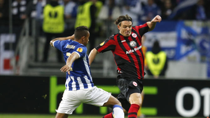Frankfurt's Alexander Meier, right, and Porto's Danilo challenge for the ball during a Europa League round of 32 second leg soccer match between Eintracht Frankfurt and FC Porto in Frankfurt, Germany, Thursday, Feb. 27, 2014