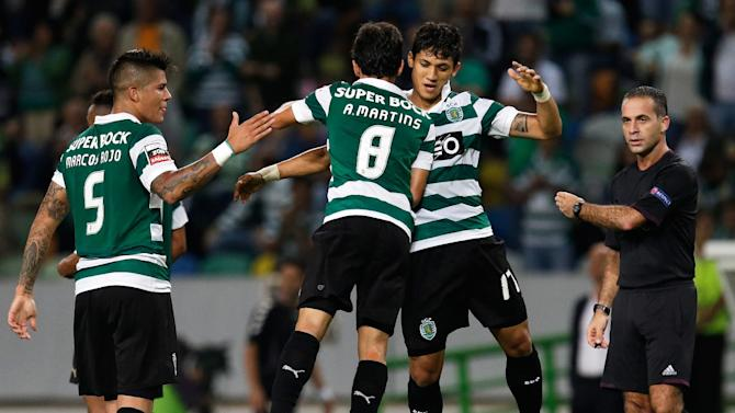 Sporting's Montero, from Colombia,  center right, celebrates with teammates Andre Martins after scoring the opening goal against Setubal  during their Portuguese league soccer match Saturday, Oct. 5 2013, at Sporting's Alvalade stadium in Lisbon