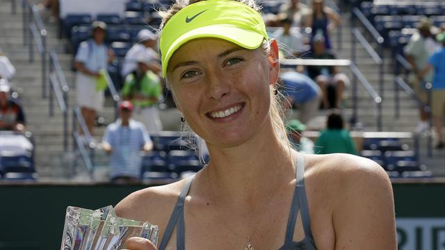 Tennis - Sharapova hammers Wozniacki to win Indian Wells title