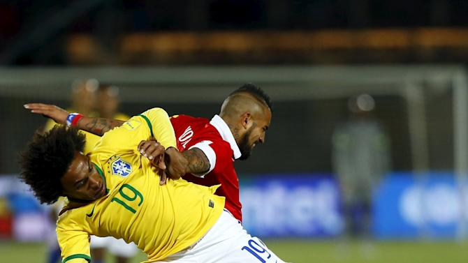 William of Brazil challenges Vidal of Chile during their 2018 World Cup qualifying soccer match in Santiago