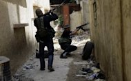 Lebanese Sunni Muslims gunmen are seen in the Bab al-Tebbaneh neighbourhood of the northern Lebanese city of Tripoli. Syrian troops have attacked a central rebel bastion, with dozens reportedly killed across the country, as the EU slaps fresh sanctions on Damascus