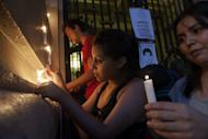 Demonstrators light candles during an anti CELAC-EU summit protest in Santiago on January 23, 2013. Latin American and European leaders open a two-day summit Saturday to give a fresh impetus to efforts to seal a free trade agreement between their two blocs