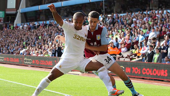 Matthew Lowton, right, netted early on as Aston Villa defeated Swansea 2-0