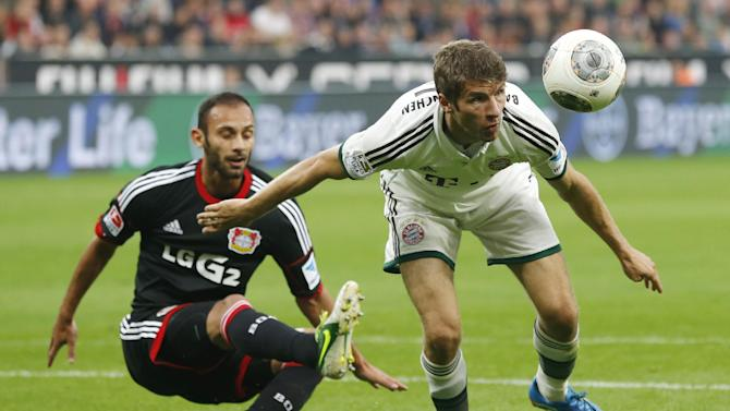 Leverkusen's Omer Toprak of Turkey, left, and Bayern's Thomas Mueller challenge for the ball during the German first division Bundesliga soccer match between Bayer Leverkusen and Bayern Munich in Leverkusen on Saturday, Oct.5, 2013