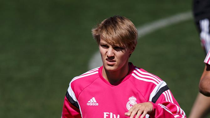 Real Madrid's Martin Odegaard warms up during a training session at Valdebebas, outside Madrid, Spain