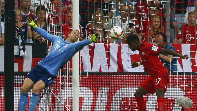 Munich's Alaba clears a shot of Leverkusen during their German first division Bundesliga soccer match in Munich