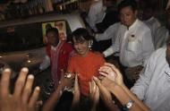 Aung San Suu Kyi is greeted by supporters as she arrives to Kawhmu township where she spends a night before country's by-elections