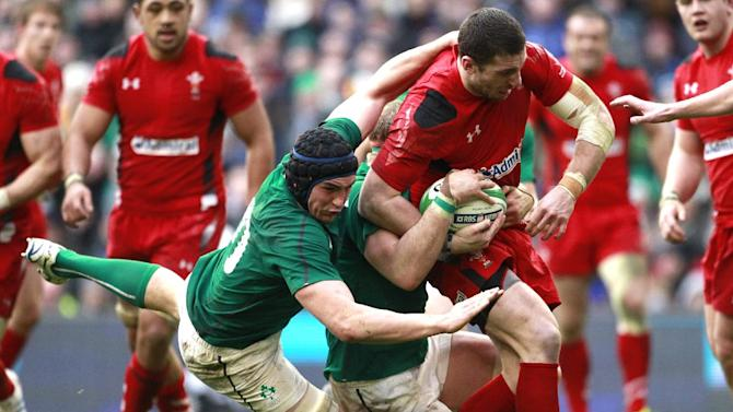 Wales Alex Cuthbert, right is tackled by Ireland's Tommy O'Donnell, left, during their Six Nations Rugby Union international match at the Aviva Stadium, Dublin, Ireland, Saturday, Feb. 8, 2014