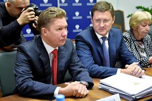 Russia's Energy Minister Alexander Novak (R) and…